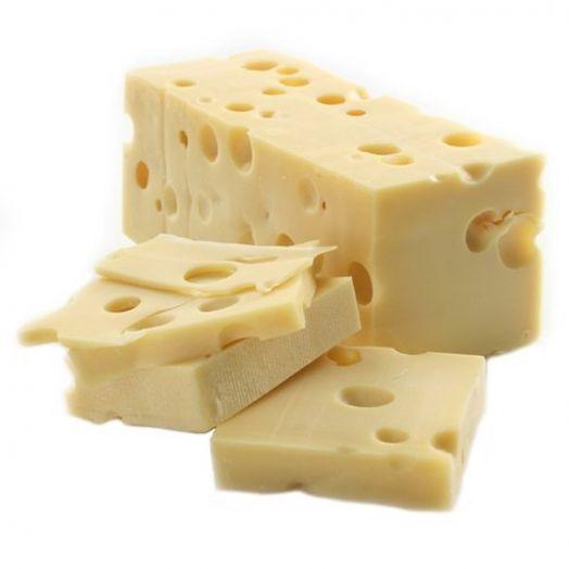 Сир Емменталь ваговий 45% 1/2 блоку ТМ Paysan Breton